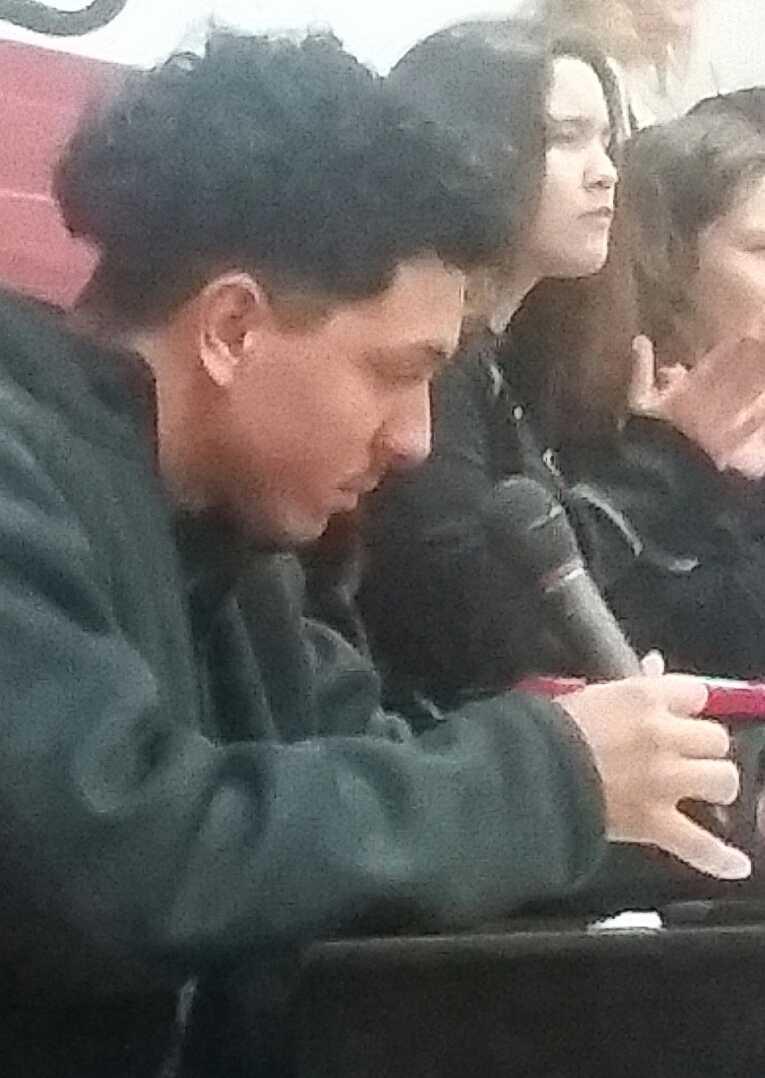 Joe Contreras announces during a Cougar basketball game.